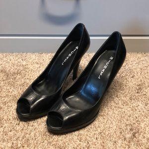 Peep toe black leather heels